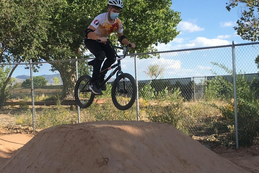 Caiden Fine 23 catches air off one of the jumps in the bike park.