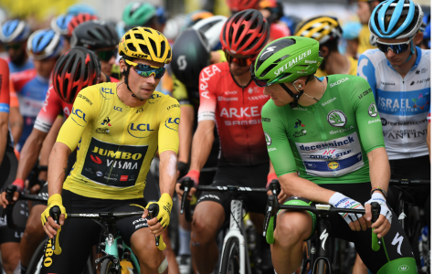 Race leader Primoz Roglic (Jumbo Visma) shares a word with green-jersey wearer, Sam  Bennett (Deceunick-Quick Step)
