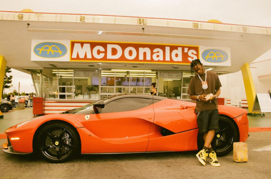 Travis Scott stands in front of the oldest McDonald's restaurant (Florence Avenue in Downey, California) with his red Ferrari. Credits to @rayscorruptedmind