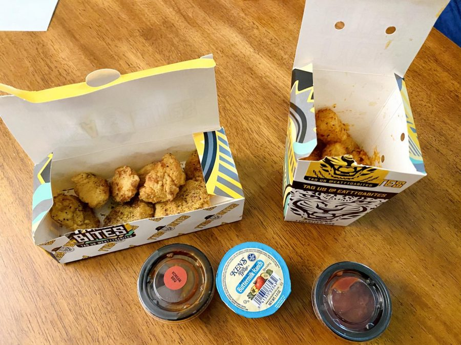 Chicken nuggets and Tater tots with a variety of sauces