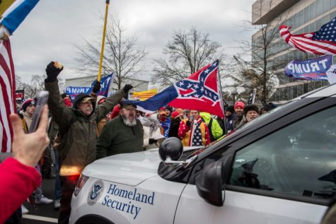Trump supporters surround a police car during riots of the Capitol Building on January 6.