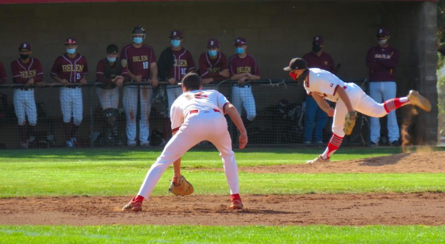 Ryan Pullen 21 delivers the pitch as Alex Gaeto 22 gets ready for action.