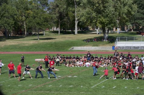 6th graders prepare to finish off the football guys in tug of war.