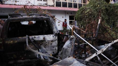 Zemari Ahmadi's totaled Toyota Corolla outside his house in Kabul, Afghanistan.